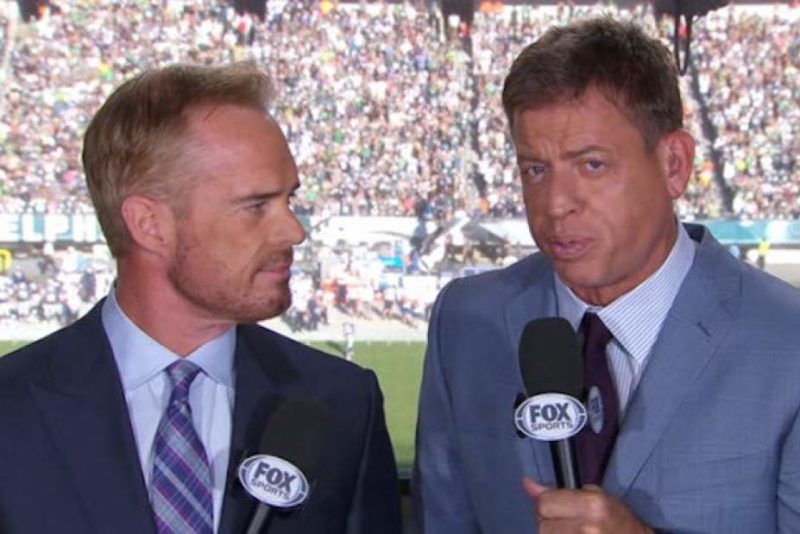 Defund The NFL: Sportscaster Troy Aikman Caught On A Hot Mic Mocking The Military & America To Support Biden During Game