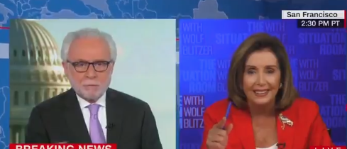 Watch: Pelosi Gets Caught Playing Games & Crumbles During Interview