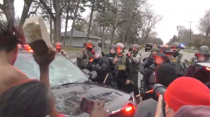 Watch: Activists Tries To Throw Massive Chunk Of Concrete At Police & Gets More than He Bargained For As Minneapolis Suburb Falls Into Chaos