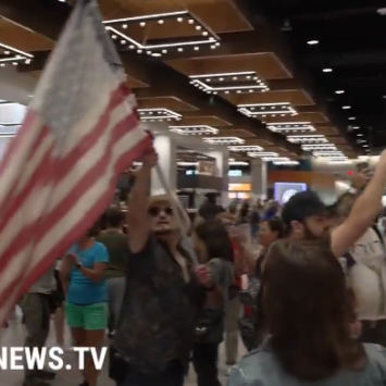 Watch: Protestors March Into 'Vaccinated Only' Area